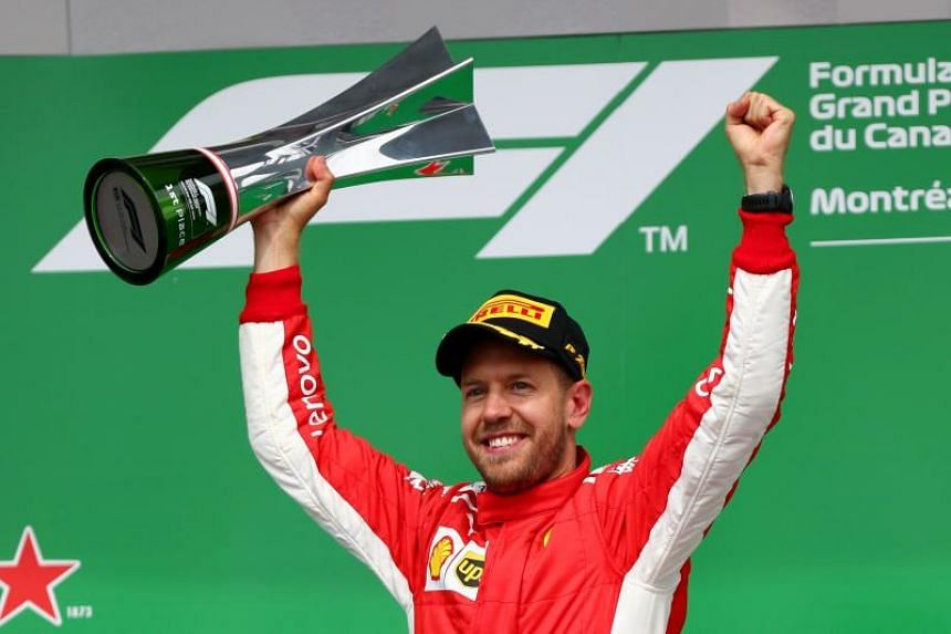 Race winner Sebastian Vettel of Germany and Ferrari celebrates on the podium with his trophy during the Canadian Formula One Grand Prix at Circuit Gilles Villeneuve on June 10, 2018 in Montreal, Canada.