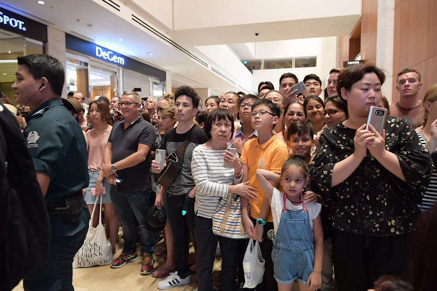 A crowd gathers at Marina Bay Sands to catch a glimpse of North Korean leader Kim Jong Un on June 11, 2018.
