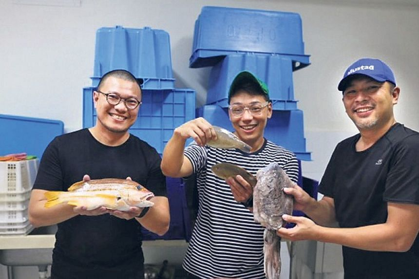 (From left) Mr Roger Wong, Mr Chen Wei Nan and Mr Christopher Chan hamming it up at Bear Bear Fresh.