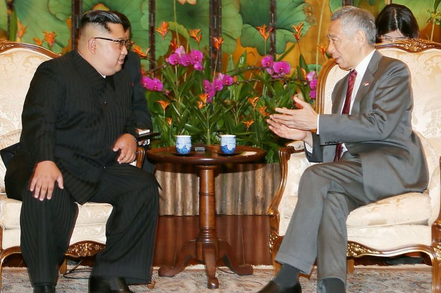 North Korean leader Kim Jong Un with Prime Minister Lee Hsien Loong at the Istana yesterday, where they discussed relations between their countries, as well as developments in North Korea and the region. Mr Lee also wished Mr Kim success for tomorrow