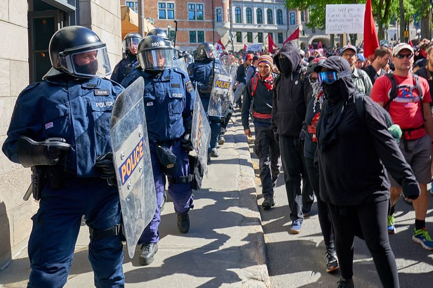 Protesters in Old Quebec confronting anti-riot police during a demonstration last Saturday against the Group of Seven summit in Canada.