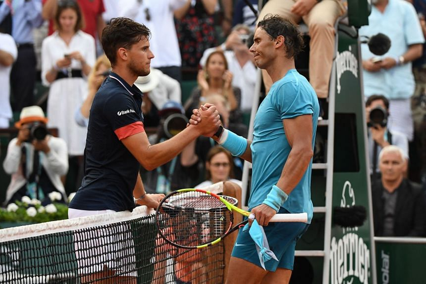 Spain's Rafael Nadal (right) is congratulated by Austria's Dominic Thiem after winning the men's singles final of the French Open tennis tournament in Paris on June 10, 2018.