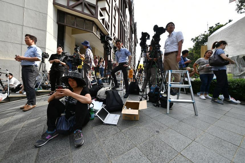 Media personnel outside Tanglin Place, opposite the St Regis where North Korean leader Kim Jong Un and his delegation are staying, on June 11, 2018.