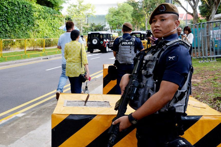 Security personnel on guard near the Shangri-La Hotel, where US President Donald Trump and his delegation will be staying, on June 10, 2018.