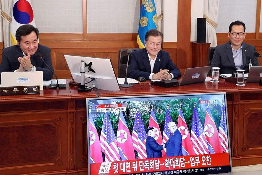 South Korean President Moon Jae In watches a live broadcast of the Trump-Kim Summit during a Cabinet meeting in Seoul, on June 12, 2018.