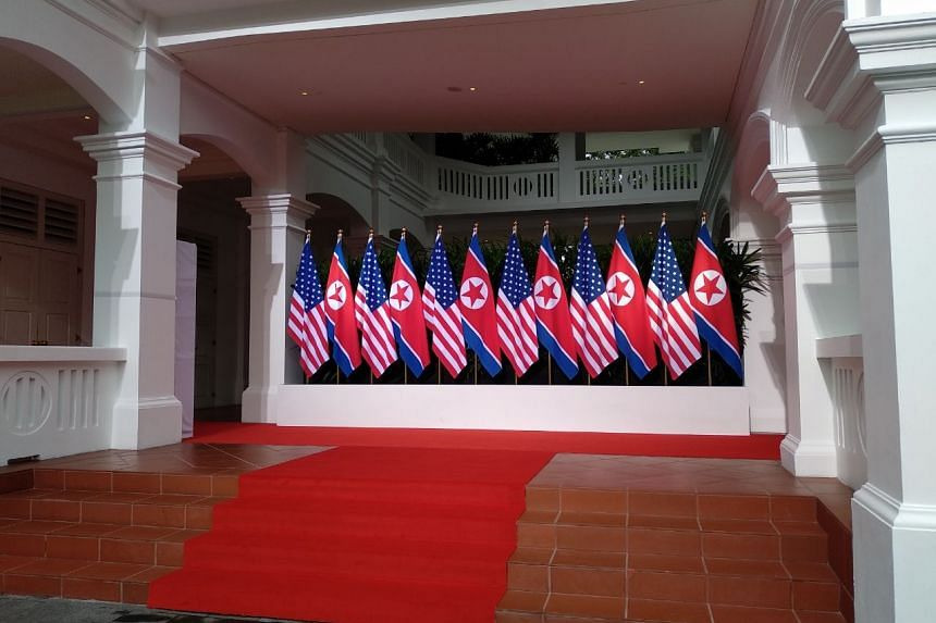 American and North Korean flags are lined inside the Capella Singapore ahead of the summit between US President Donald Trump and North Korean leader Kim Jong Un, on June 12, 2018.