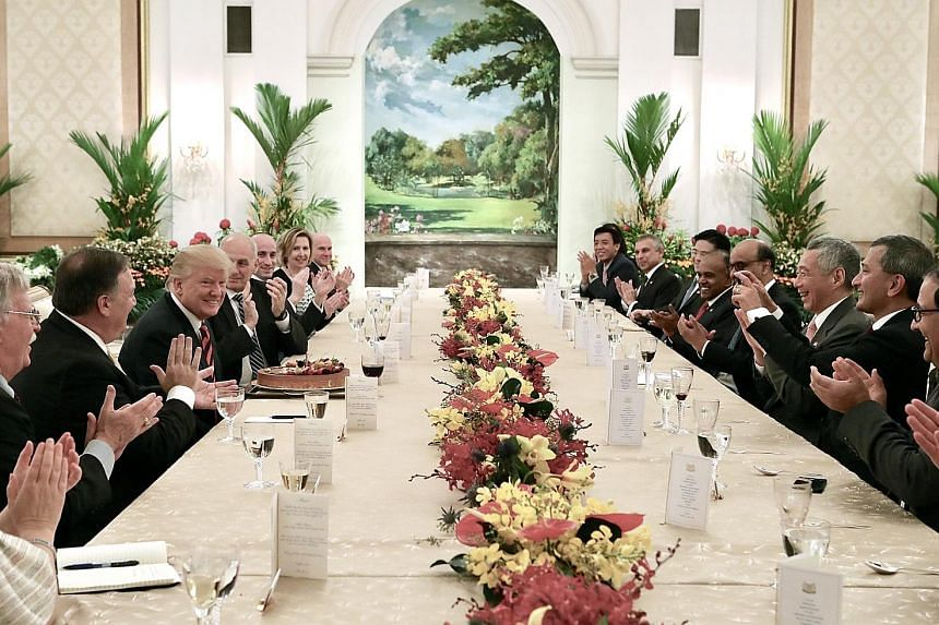 Mr Trump meeting PM Lee at the Istana yesterday, where they discussed a wide range of regional and global developments. US President Donald Trump smiling after he blew out a candle on his birthday cake during lunch with Prime Minister Lee Hsien Loong