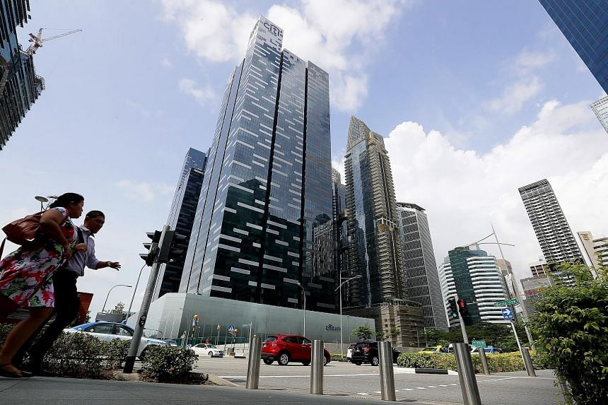 "The Citibank Singapore building in Asia Square. Between 2016 and this year, Citi's consumer bank operations for Asia ""cost-to-serve"" fell by 10 per cent, with the net income in the first quarter now at US$1.12 billion (S$1.5 billion). Asia remains th"