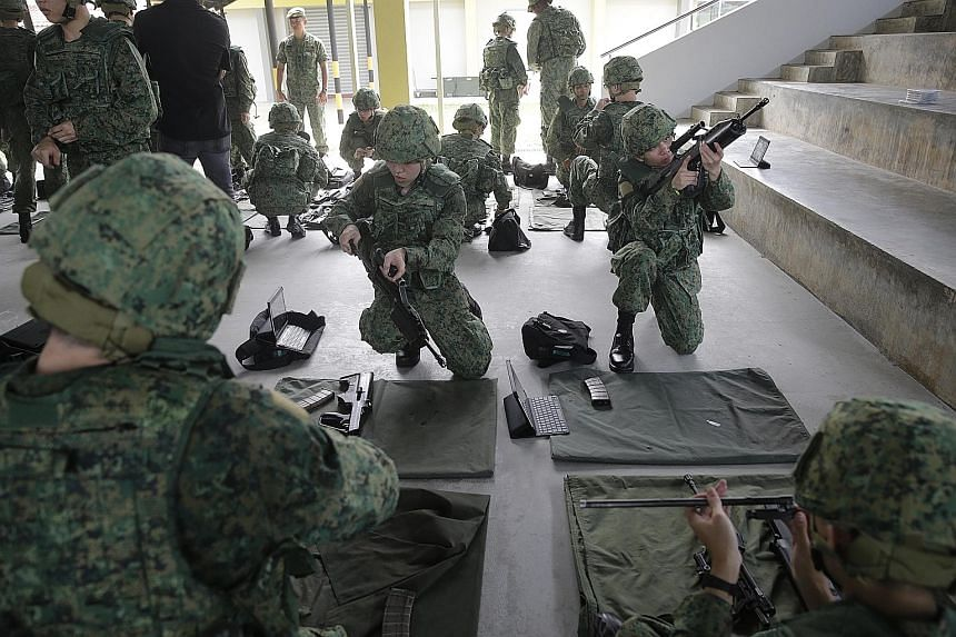 Recruits undergo weapon-handling training with the SAR21 rifle at the Singapore Armed Forces Basic Military Training Centre on Pulau Tekong. Closed to the public since 1987, the island is now a permanent military base used for the training of new nat
