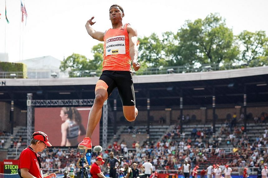 Juan Miguel Echevarria of Cuba making his 8.83m jump. It cannot be regarded as a record owing to the 2.1m/sec tailwind.