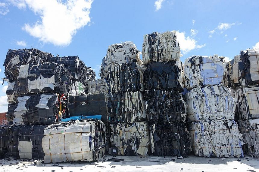 As China bans the import of more types of solid waste, there is growing fear that the hazardous materials would find their way into other parts of the region. Tonnes of old electronic products piled up inside a factory compound in Samut Prakan provin