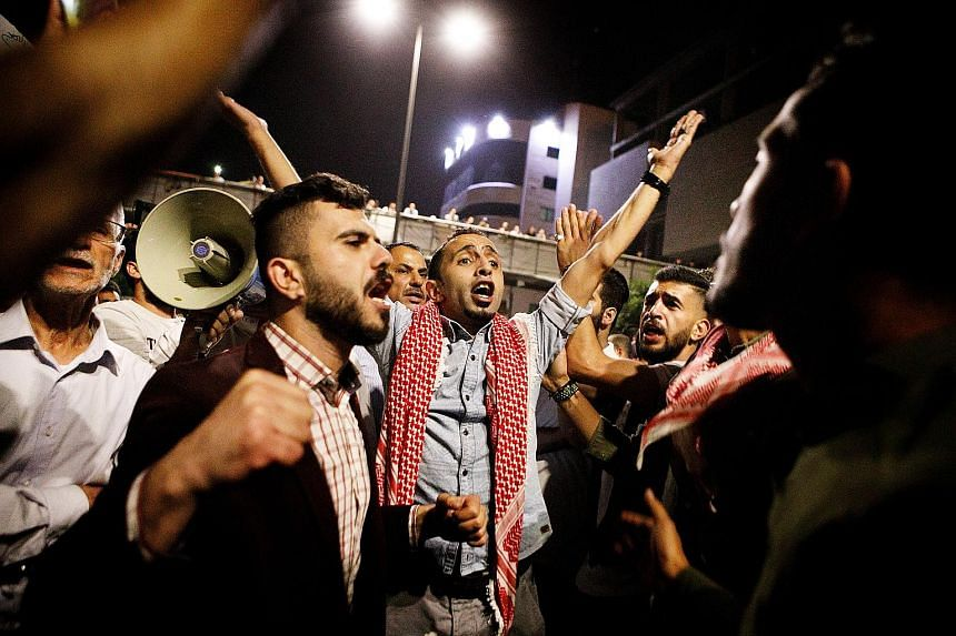 Austerity measures tied to an International Monetary Fund loan have seen prices of basic necessities rise across Jordan, leading to angry protests in cities including Amman (left) over tax proposals that forced prime minister Hani Mulki to resign las
