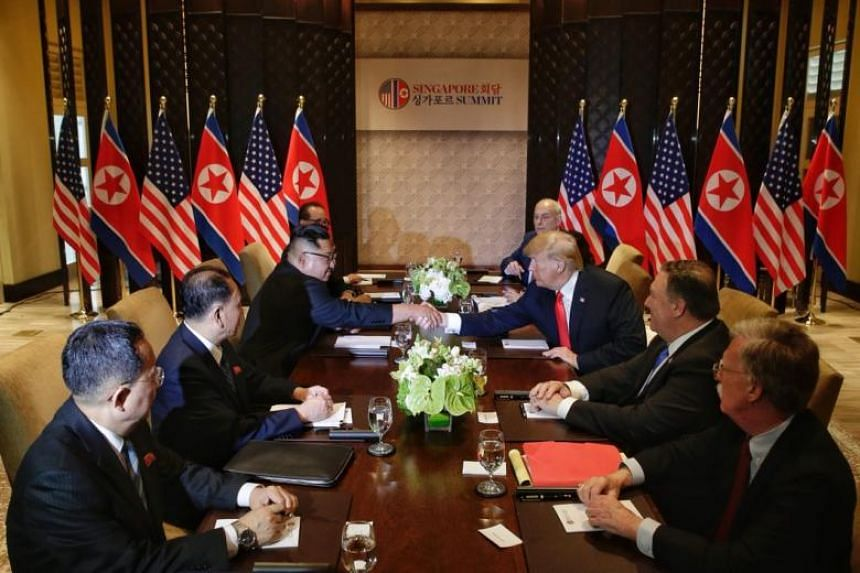 US President Donald Trump and North Korean leader Kim Jong Un shaking hands during an expanded meeting at Capella Singapore on June 12, 2018.