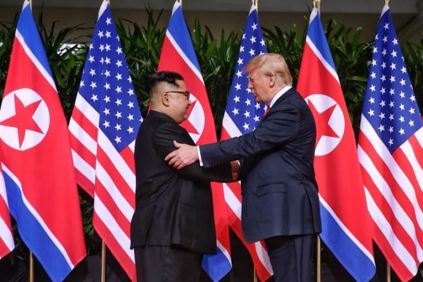US President Donald Trump and North Korean leader Kim Jong Un exchanging a historic handshake on June 12, 2018.