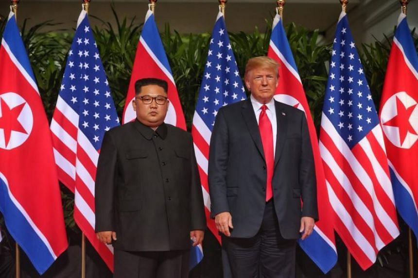 US President Donald Trump and North Korean leader Kim Jong Un at the courtyard of Capella Singapore before their meeting on June 12, 2018.