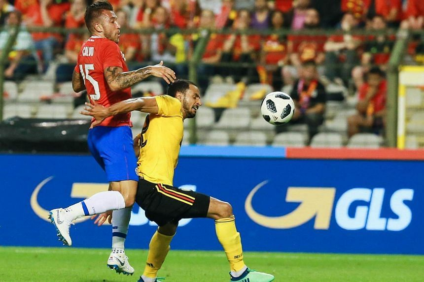 Francisco Calvo of Costa Rica (left) and Naser Chadli of Belgium in action during a friendly soccer match between Belgium and Costa Rica at the King Baudouin stadium in Brussels, Belgium, on June 11, 2018.