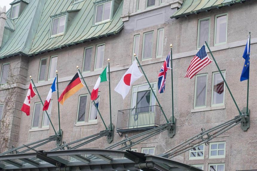 Flags fly over the Fairmont Le Manoir Richelie hotel, the location for the G7 summit, in La Malbaie, Quebec.