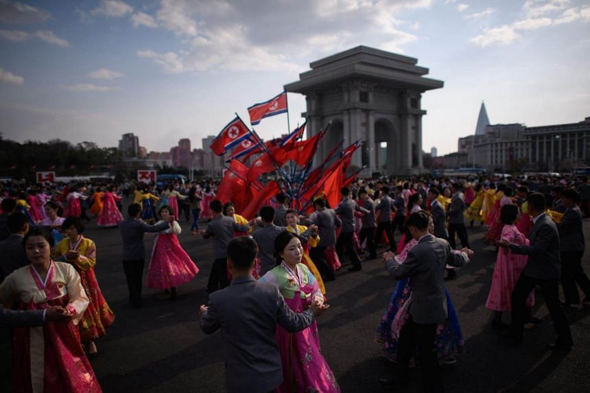 Students take part in a mass dance event during celebrations marking the anniversary of the birth of late North Korean leader Kim Il Sung in Pyongyang, on April 15, 2018.
