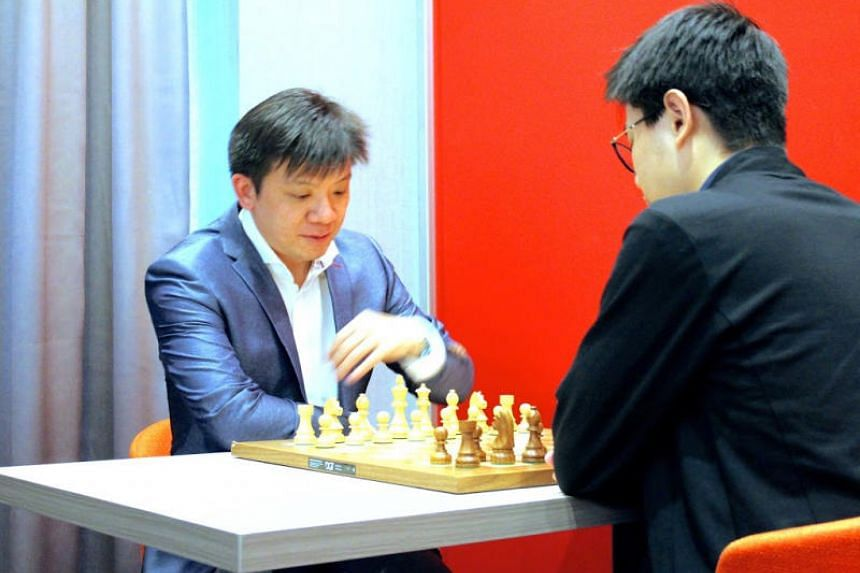 International master Goh Wei Ming Kevin (left) is now one tournament away from becoming Singapore's second chess grandmaster.