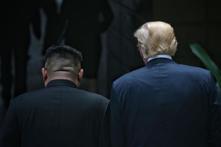 US President Donald Trump and North Korean leader Kim Jong Un strolling through the courtyard of Capella Singapore on June 12, 2018.