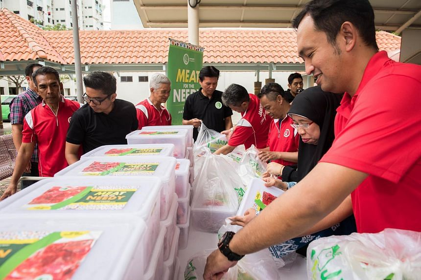 Representatives from Jamiyah Singapore preparing to distribute packets of mutton to beneficiaries at the Multi-Purpose hall beside Nee Soon Central Community Centre on June 12, 2018.