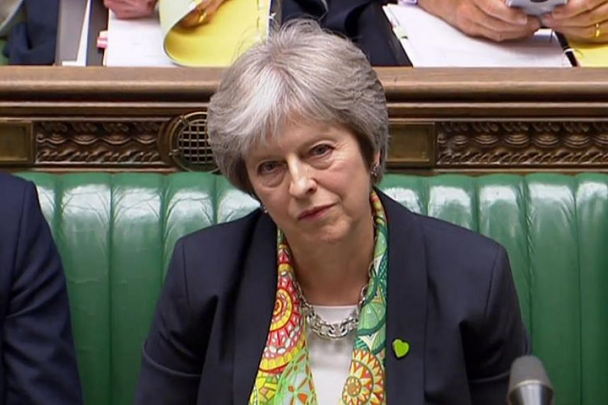 Britain's Prime Minister Theresa May listens to a question while speaking on the G-7 summit, in the House of Commons in London on June 11, 2018.
