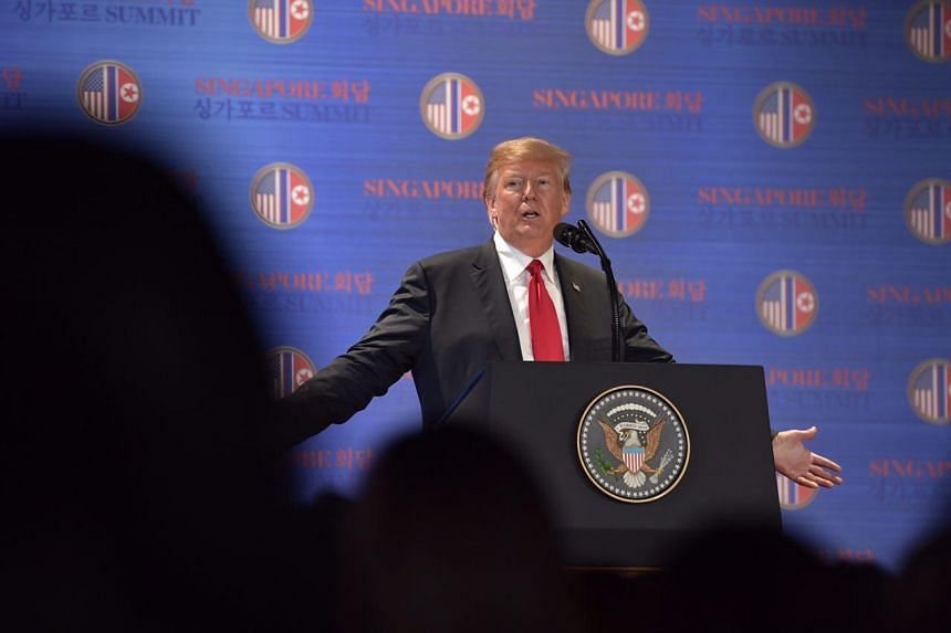 US President Donald Trump speaks during a press conference at Capella Singapore, on June 12, 2018.