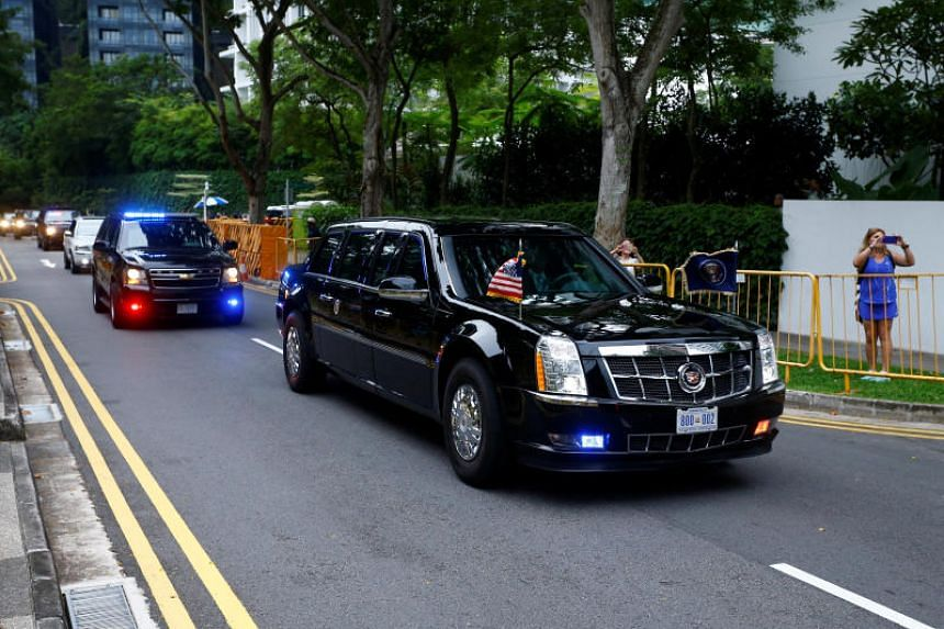The motorcade of US President Donald Trump travels towards Sentosa for his meeting with North Korean leader Kim Jong Un, in Singapore June 12, 2018.