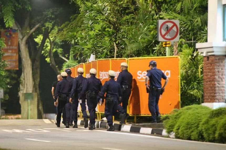 Police officers preparing for the historic summit on the resort island of Sentosa.