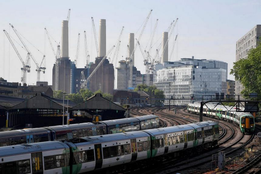 Trains pass near construction work taking place around Battersea Power Station in London, Britain, on May 22, 2018.