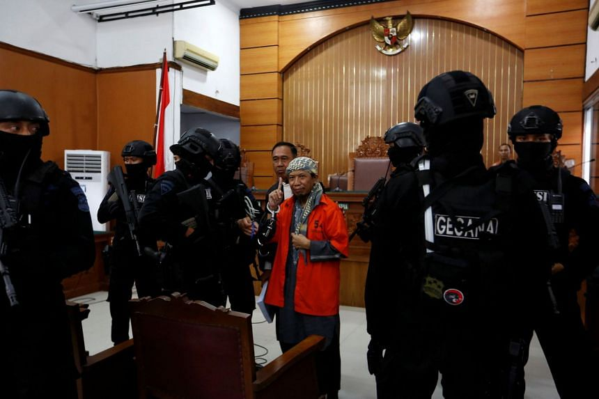 Radical cleric Aman Abdurrahman inside a courtroom at his trial in Jakarta, Indonesia, on May 25, 3018.