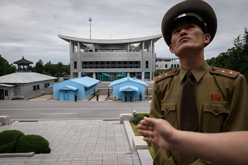 North Korean soldier, Lieutenant-Colonel Hwang Myong Jin, standing before the South Korean side of the truce village of Panmunjom on the North Korean side of the Demilitarised Zone, on June 11, 2018.