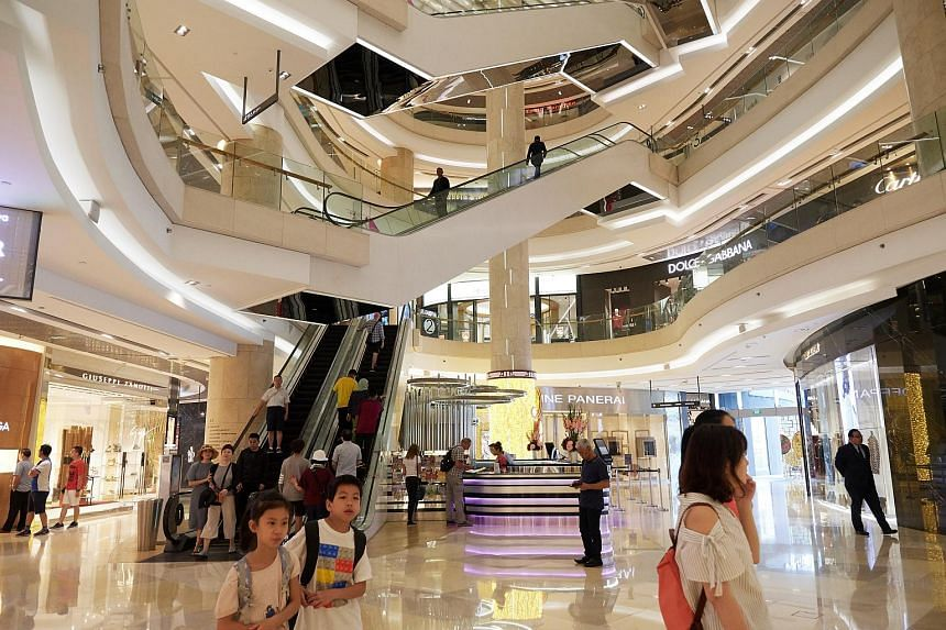 Shoppers at ION Orchard. Singapore retail sales rose marginally by 0.4 per cent compared to a year ago, following March's 1.1 per cent drop.