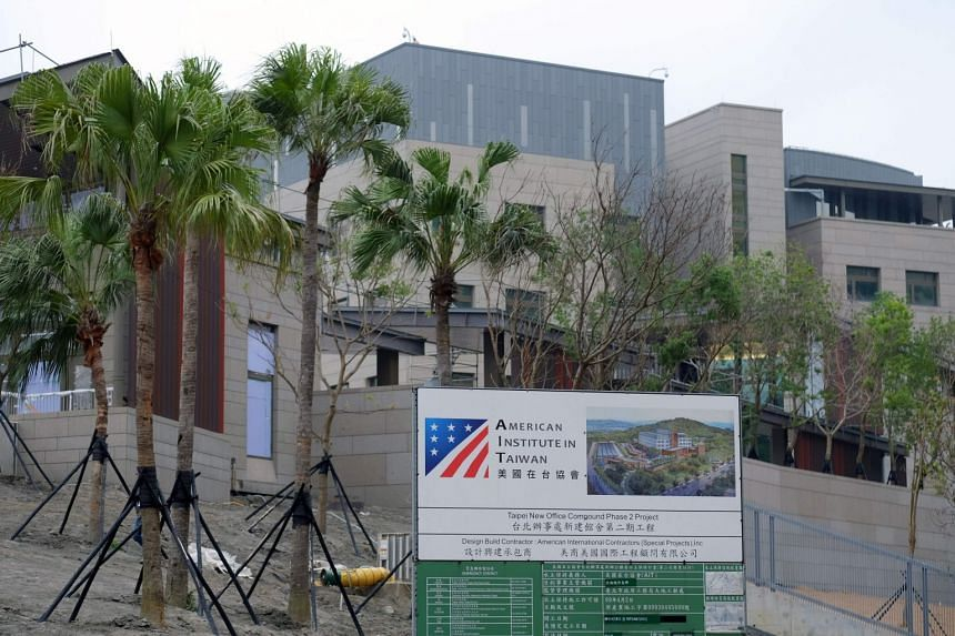 A construction signage is seen in front of the newly-built American Institute in Taipei (AIT) building in Taipei, on May 3, 2018.