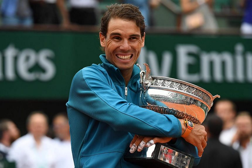 Spain's Rafael Nadal poses with the Mousquetaires Cup after his victory in the men's singles final match against Austria's Dominic Thiem in The Roland Garros 2018 French Open tennis tournament.
