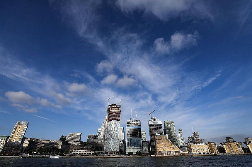 The Canary Wharf district in London. One measure of a city's confidence and attractiveness is the number of cranes adorning its skyline as new office buildings are constructed. While skyscrapers are still springing up in London, Paris has embarked on