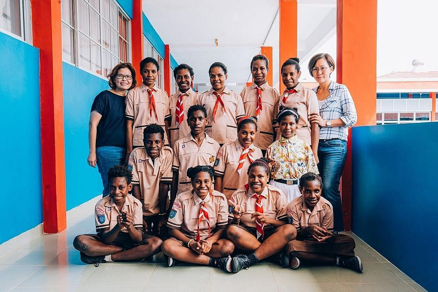 Madam Sheela Zee (left) and Madam Nicole Ng with some of the children from Mentari Dunia orphanage in Batam. The home has 15 children from Indonesia's Papua province - 12 girls and three boys aged 10 to 14.