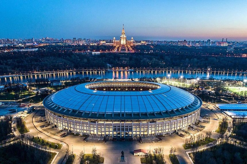 An aerial view of Moscow taken with a drone shows a lit-up Luzhniki Stadium, which will host both the World Cup opener and final, with the main building of the Moscow State University in the background.