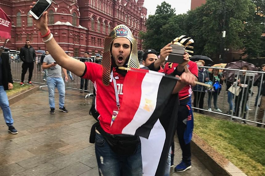 Yes Czar, the Pharoahs have arrived. An Egyptian fan in appropriately fitting national garb gets in on the festivities in Moscow.