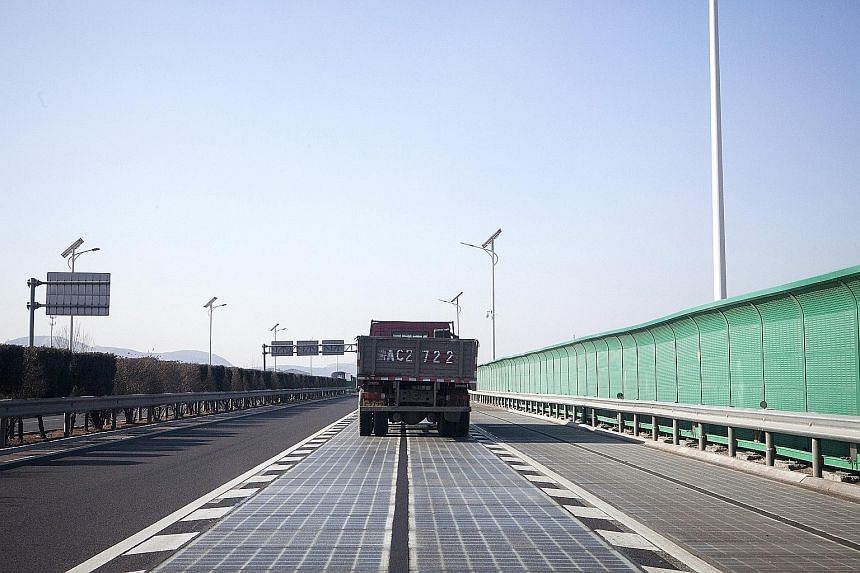 A truck using the solar road in Jinan in China's Shandong province. While this method could save space and bring renewable energy closer to homes, there are also challenges such as safety concerns, higher relative cost and lower efficiency compared t