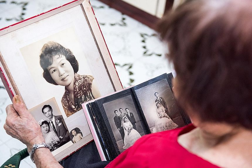 Madam Kok Yoon Hin sharing her memories. She was born in China, grew up in Malaysia and later settled down in Singapore. Her husband Kong Kwan Thong, a shipyard worker, died in 2006, aged 75.