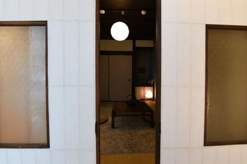 A Japanese traditional tatami-mat room in short-term accommodation operated by Hyakusenrenma's rental house in Tokyo.