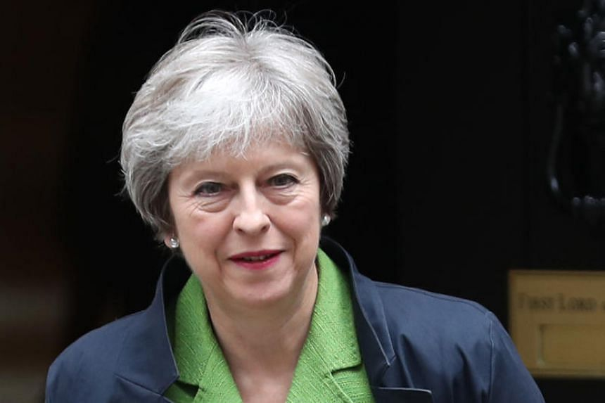Britain's Prime Minister Theresa May leaves 10 Downing Street in central London on June 12, 2018.