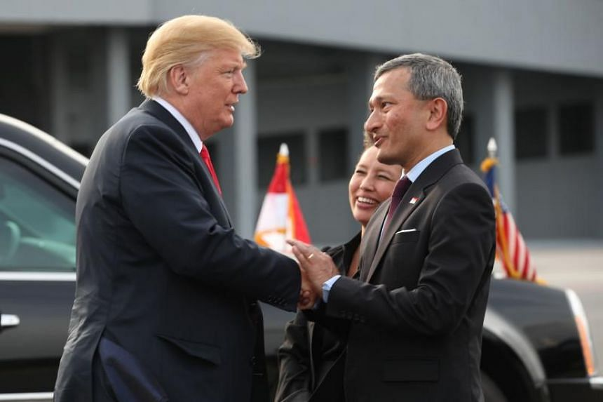 US President Donald Trump shaking hands with Singapore's Minister for Foreign Affairs Vivian Balakrishnan (right) before departing from Paya Lebar Air Base in Singapore, on June 12, 2018.