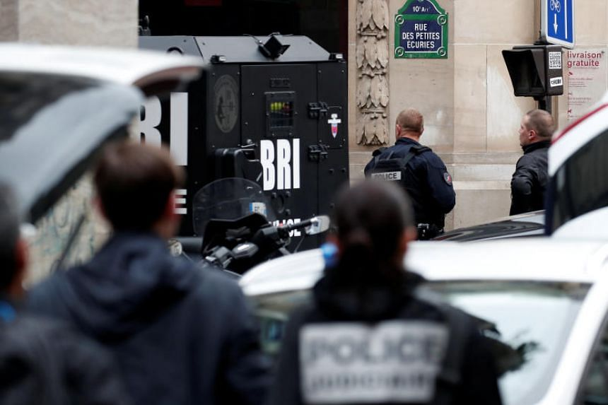 French police and special police forces (BRI) secure the street as a man has taken people hostage at a business in Paris, France, on June 12, 2018.