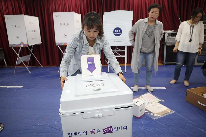 A polling station at a community centre being set up in northern Seoul, South Korea, on June 12, 2018.