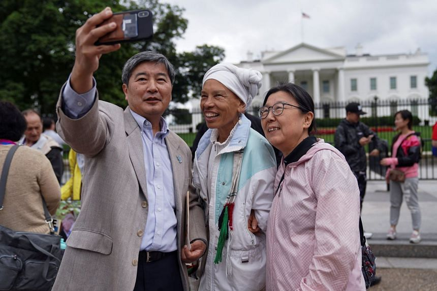 (From left) Korean-American H. K. Suh, Lucy Murphy and Kate Shim, also Korean-American, taking a wefie outside the White House to celebrate the summit between US President Donald Trump and North Korean leader Kim Jong Un.