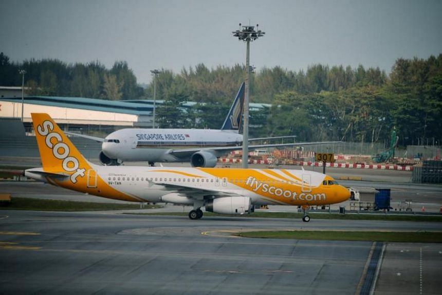 A Scoot Airbus A320 and a Singapore Airlines passenger plane on the tarmac of Changi Airport. Both airlines have come under fire for naming Taiwan as part of China.