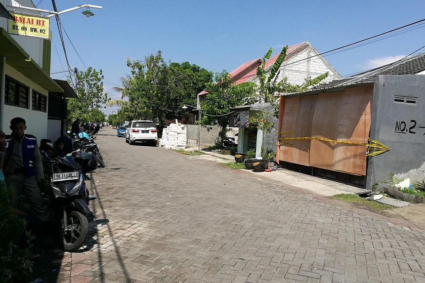 Yellow police line placed on bomber Tri Murtiono's house in Surabaya.