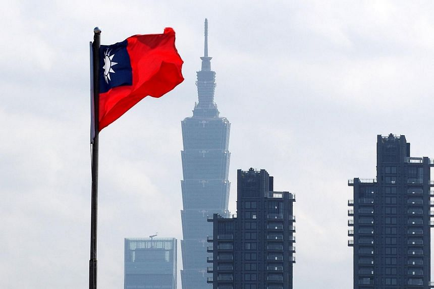 Taiwan's national flag flies in front of the Taipei 101 skyscraper in Taipei, Taiwan, on March 1, 2018.